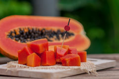 Sliced fresh Papaya fruit on wooden table with nature background.  Royalty Free Stock Image