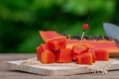 Sliced fresh Papaya fruit on wooden table with nature background.  Stock Photos
