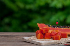 Sliced fresh Papaya fruit on wooden table with nature background.  Royalty Free Stock Photos