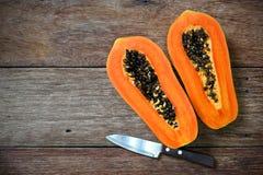 Sliced fresh papaya with knife Stock Image