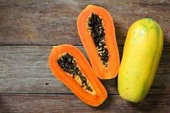 Sliced fresh papaya on wooden Royalty Free Stock Photo