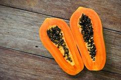 Sliced fresh papaya on wooden Stock Photo