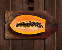 Sliced fresh papaya on wooden background Royalty Free Stock Photography
