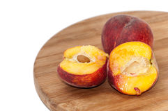 Sliced fresh peaches on the wooden board Stock Images