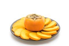 sliced fresh persimmon Royalty Free Stock Photo