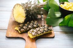 Sliced fresh pineapple on a wooden background Royalty Free Stock Photos