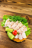Sliced fresh pork lard, fresh produce, vegetables on the wooden board Stock Photos