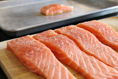 Sliced of fresh red salmon on wooden cutting board. Deliciously Royalty Free Stock Photo