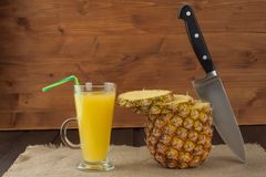 Sliced fresh, ripe pineapple on a wooden table. Preparation of dietary supplements. Sliced fresh, ripe pineapple on a wooden table. Preparation of dietary Royalty Free Stock Image