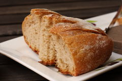Sliced fresh rye sourdough bread. Served on plate Stock Photography