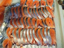 Sliced fresh salmon fish on the market stock photography