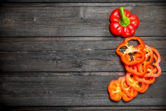 Sliced fresh sweet pepper. On wooden background royalty free stock photography