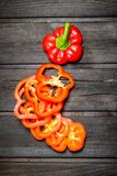 Sliced fresh sweet pepper. On wooden background royalty free stock images