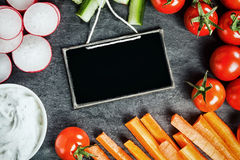 Sliced fresh vegetable frame around a slate Stock Photo