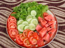 Sliced fresh vegetables. Folded on a plate Royalty Free Stock Photos