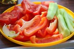 Sliced fresh vibrant vegetables, bulgarian pepper, cucumber, tom Royalty Free Stock Image