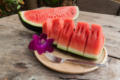 Sliced Fresh water melons on wood plate Royalty Free Stock Photography