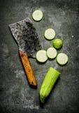 Sliced fresh zucchini old hatchet. Stock Photo