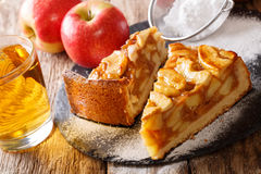 Sliced freshly baked apple pie close-up and juice. horizontal. Sliced freshly baked apple pie close-up on a table and juice. horizontal Stock Image