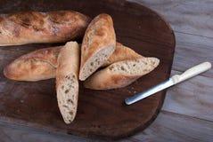 Sliced Freshly Baked Baguette on Wooden Board. Stock Images