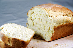 A sliced, freshly baked loaf of bread. Royalty Free Stock Photos
