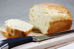 A sliced, freshly baked loaf of bread. Royalty Free Stock Images