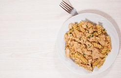 Sliced fried chicken fillet in a creamy and mustard sauce. with fusilli pasta Stock Photography