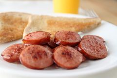 Sliced and fried kielbasa Stock Photos