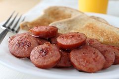 Sliced and fried kielbasa sausage Royalty Free Stock Photo