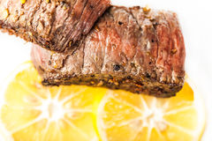 Sliced fried meat with slices of lemon closeup Royalty Free Stock Photography