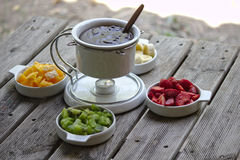 Sliced Fruit Fondue. Delicious fruit fondue with orange, banana, strawberry and kiwi stock photo