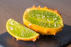 Sliced Fruit Kivano melon on wooden background. Close up royalty free stock photography