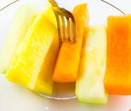 Sliced fruit on plate Royalty Free Stock Photo