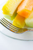 Sliced fruit on plate Stock Photo