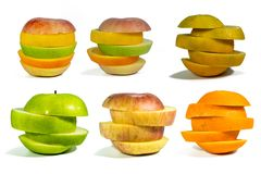 Sliced fruit, stacked isolated add paths on a white background royalty free stock photography