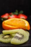 Sliced fruit (strawberries, kiwi, orange, banana) Royalty Free Stock Images