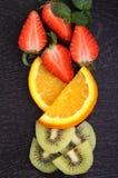 Sliced fruit (strawberries, kiwi, orange, banana) Stock Image