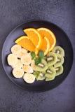 Sliced fruit (strawberries, kiwi, orange, banana) Stock Photo
