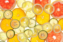 Sliced fruits background Stock Photography