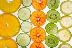 Sliced fruits background Stock Image