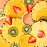 Sliced Fruits Background. Strawberry, Kiwi, Pineapple Stock Images