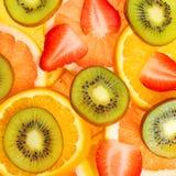 Sliced Fruits Background. Strawberry, Kiwi, Pineapple, Grapefruit and Orange Stock Image
