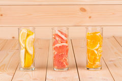 Sliced fruits in collins glasses. Royalty Free Stock Photography