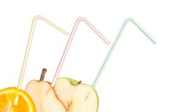 Sliced fruits with drinking straw Royalty Free Stock Photos