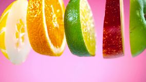Sliced fruits falling in water splash royalty free stock images