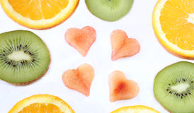 Sliced fruits with heart shaped sliced plums Royalty Free Stock Images