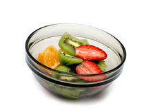 Sliced Fruits II. Sliced strawberry, orange and kiwi in a bowl, isolated Stock Images