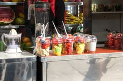 Sliced fruits stall royalty free stock images