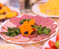 Sliced  Gammon Ham with vegetables for Festive dinner, Christmas dinner, Holiday table, Thanksgiving day celebration Royalty Free Stock Photography