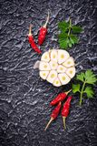 Sliced garlic and red pepper on dark background. Top view Royalty Free Stock Photos